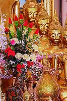 "Flowers on altar in bot of ""Luang Pho To"" Wat Intharawihan, Bangkok, Thailand."