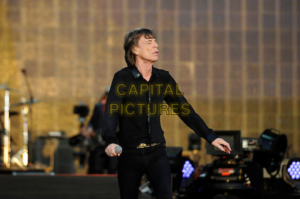 Mick Jagger of The Rolling Stones <br /> performing at Barclaycard British Summertime, Hyde Park, London, England, UK, <br /> 13th July 2013.<br /> music concert gig festival live on stage half length black shirt microphone arms dancing <br /> CAP/MAR <br /> &copy; Martin Harris/Capital Pictures