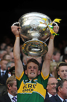 Donnadha Walsh lifts the Sam Maguire Cup to celebrate  Kerry's victory over Donegal in the All-Ireland Football Final against  in Croke Park 2014.<br /> Photo: Don MacMonagle<br /> <br /> <br /> Photo: Don MacMonagle <br /> e: info@macmonagle.com