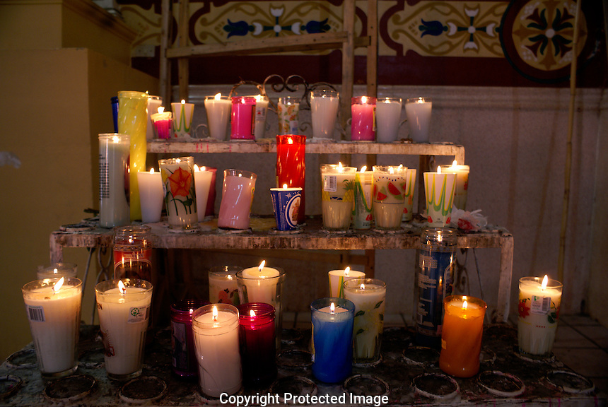 Votive candles burning in the church in Catemaco, Veracruz, Mexico