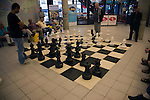 Men playing chess with a giant set of board and pieces in the central library, Rotterdam, Netherlands