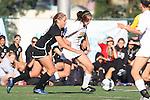 Manhattan Beach, CA 01/25/10 - Kendall Richter (Mira Costa #8) and Madison Murry (Palos Verdes #20) battle at midfield during the second half of the Palos Verdes - Mira Costa girl soccer game, Palos Verdes defeated Mira Costa 2-0.