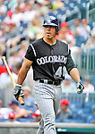 10 July 2011: Colorado Rockies outfielder Cole Garner returns to the dugout during a game against the Washington Nationals at Nationals Park in Washington, District of Columbia. The Nationals shut out the visiting Rockies 2-0 salvaging the last game their 3-game series at home prior to the All-Star break. Mandatory Credit: Ed Wolfstein Photo
