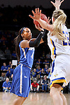 SIOUX FALLS, SD - MARCH 5:  Kamilan Carter #4 from IPFW shoots over Chloe Conemann #22 from South Dakota State during the Summit League Basketball Championship Saturday in Sioux Falls.  (Photo by Dave Eggen/Inertia)