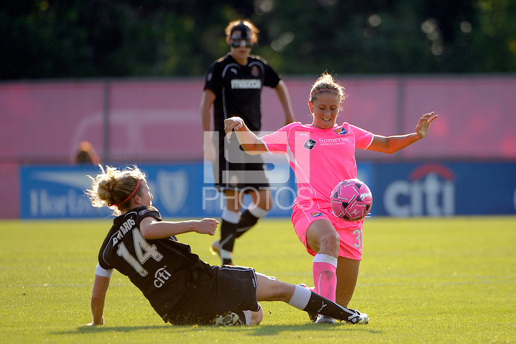 Becky Edwards (14) of the Western New York Flash goes for a tackle on Carolyn Blank (31) of Sky Blue FC. The Western New York Flash defeated Sky Blue FC 2-0 during a Women's Professional Soccer (WPS) match at Yurcak Field in Piscataway, NJ, on July 17, 2011.
