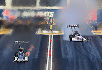 Feb 28, 2016; Chandler, AZ, USA; NHRA top fuel driver Dave Connolly (left) defeats Richie Crampton during the Carquest Nationals at Wild Horse Pass Motorsports Park. Mandatory Credit: Mark J. Rebilas-USA TODAY Sports