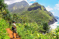 A state park ranger pauses to look at the ocean along the Kalalau Trail near Hanakapi'ai Beach, northern Kaua'i.