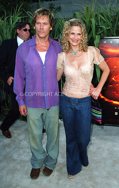 "Kevin Bacon and Kyra Sedgwick arrive at the world premiere of Touchstone Pictures' movie, ""Signs"" at Lincoln Center, New York. July 29, 2002. Please byline: Alecsey Boldeskul/NY Photo Press.   ..*PAY-PER-USE*      ....NY Photo Press:  ..phone (646) 267-6913;   ..e-mail: info@nyphotopress.com"