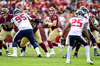 Landover, MD - November 18, 2018: Washington Redskins quarterback Colt McCoy (12) drops back to pass the football during second half action of game between the Houston Texans and the Washington Redskins at FedEx Field in Landover, MD. The Texans defeated the Redskins 23-21. (Photo by Phillip Peters/Media Images International)