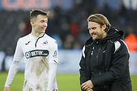 (L-R) Bersant Celina of Swansea City is greeted by Bjorn Hamberg, assistant coach for Swansea during the FA Cup Fourth Round match between Swansea City and Gillingham at the Liberty Stadium, Swansea, Wales, UK. Saturday 26 January 2019