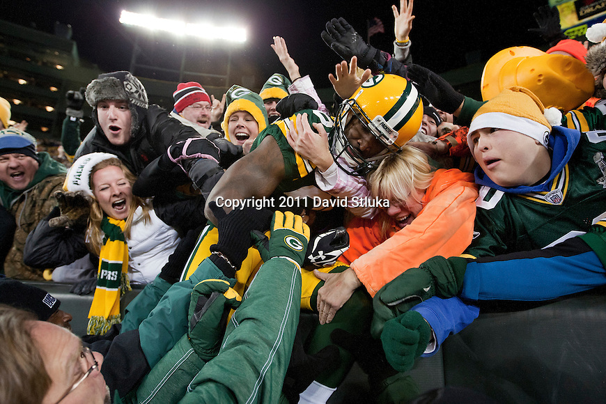 Green Bay Packers wide receiver James Jones (89) celebrates with a Lambeau Leap into the stands during a week 16 NFL football game against the Chicago Bears on December 25, 2011 in Green Bay, Wisconsin. The Packers won 35-21. (AP Photo/David Stluka)