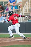 Alexander Simon (23) of the Kannapolis Intimidators follows through on his swing against the Delmarva Shorebirds at CMC-Northeast Stadium on June 6, 2015 in Kannapolis, North Carolina.  The Shorebirds defeated the Intimidators 7-2.  (Brian Westerholt/Four Seam Images)