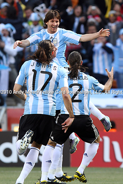 17 JUN 2010:  Teammates celebrate the second goal by Gonzalo Higuain (ARG)(visible behind #17).  The Argentina National Team defeated the South Korea National Team 4-1 at Soccer City Stadium in Johannesburg, South Africa in a 2010 FIFA World Cup Group E match.