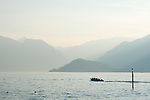 A view of Villa Balbianello and a boat on Lake Como, Italy
