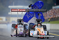 Oct. 6, 2012; Mohnton, PA, USA: NHRA top fuel dragster driver Rit Pustari (left) hits the back tire on the car of Clay Millican during qualifying for the Auto Plus Nationals at Maple Grove Raceway. Mandatory Credit: Mark J. Rebilas-