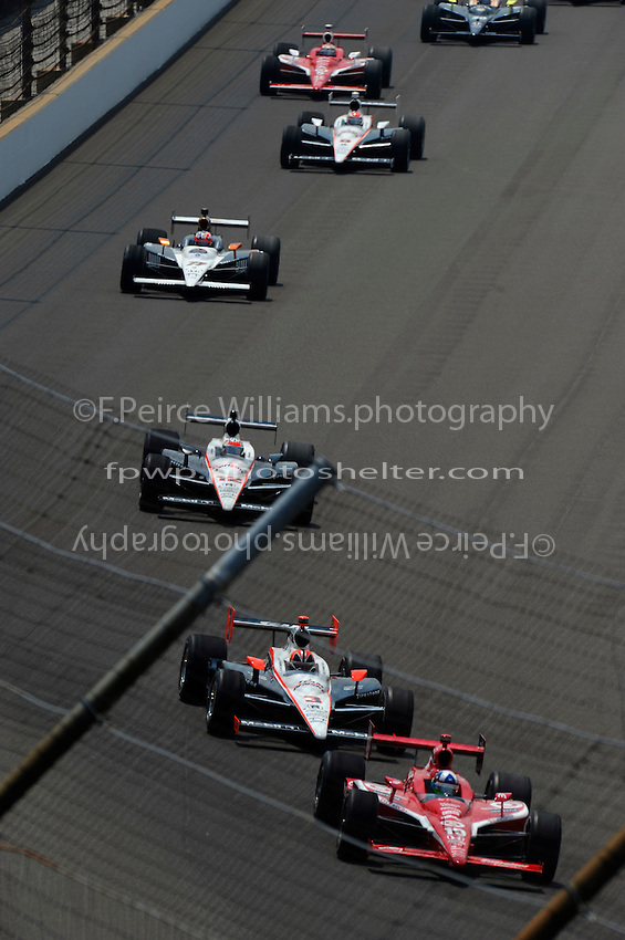 Dario Franchitti (#10) leads Helio Castroneves (#3), Will Power (#12), Alex Tagliani (#77), Ryan Briscoe (#6) and Scott Dixon (#9).