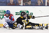 Joe Houk (UML - 4), Brandon Fagerheim (AIC - 22) - The University of Massachusetts Lowell River Hawks defeated the visiting American International College Yellow Jackets 6-1 on Tuesday, December 3, 2013, at Tsongas Arena in Lowell, Massachusetts.