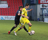 Richie Brittain tackles Kenny McLean in the Ross County v St Mirren Scottish Professional Football League match played at the Global Energy Stadium, Dingwall on 17.1.15.