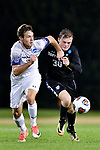 GREENSBORO, NC - DECEMBER 02: Dakota Rosenberg #15 battles Peder Nalum Olsen #30 of North Park University for the ball during the Division III Men's Soccer Championship held at UNC Greensboro Soccer Stadium on December 2, 2017 in Greensboro, North Carolina. Messiah College defeated North Park University 2-1 to win the national title. (Photo by Grant Halverson/NCAA Photos via Getty Images)