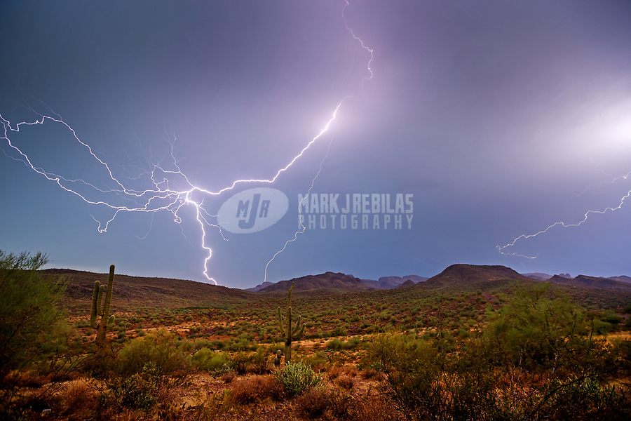 Sep 5, 2017; Lake Pleasant, Arizona, USA;   Lightning strikes over the desert near Lake Pleasant during a summer monsoon thunderstorm. Mandatory Credit: Mark J. Rebilas