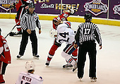 February 22nd 2008:  Matt Carkner (22) of the Binghamton Senators fights Anthony Stewart (24) of the Rochester Amerks as linesman Michael Baker, and Jeff Walker (17) wait at Blue Cross Arena at the War Memorial in Rochester, NY.  The Senators defeated the Amerks 4-0.   Photo copyright Mike Janes Photography