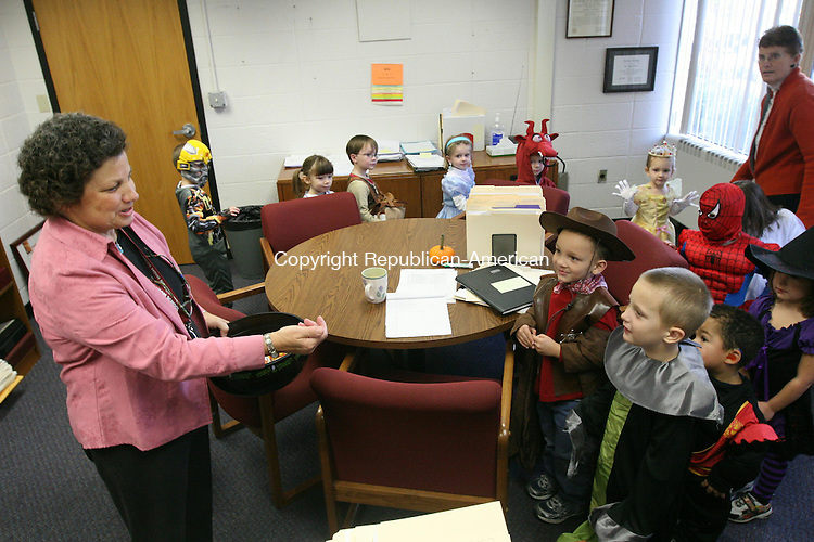 TORRINGTON, CT - 28 October, 2010 - 102810MO04 - Torrington High School Principal Joanne Creedon greets a class from the schools Preschool Lab who went trick or treating in the school on Thursday. Jim Moore Republican-American.