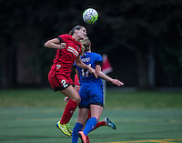 Seattle, WA - Saturday, May 14, 2016: Portland Thorns FC defender Katherine Reynolds (2) goes up for a header Seattle Reign FC midfielder Beverly Yanez (17) during the first half. The Portland Thorns FC and the Seattle Reign FC played to a 1-1 tie during a regular season National Women's Soccer League (NWSL) match at Memorial Stadium.