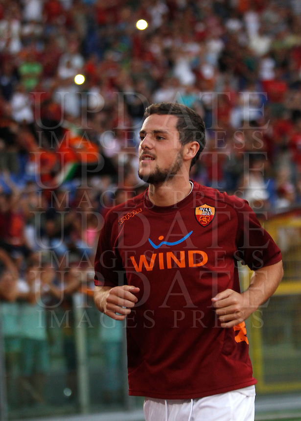 Calcio: partita amichevole Roma-Aris Salonicco. Roma, stadio Olimpico, 19 agosto 2012..AS Roma forward Mattia Destro enters the pitch prior to the start of the football friendly match between AS Roma and Aris Thessaloniki, at Rome, Olympic stadium, 19 August 2012..UPDATE IMAGES PRESS/Isabella Bonotto