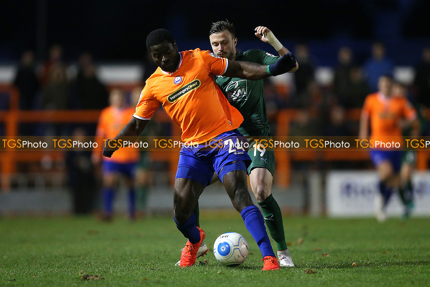 George Elokobi of Braintree Town and Andrew Mangan of Tranmere Rovers during Braintree Town vs Tranmere Rovers, Vanarama National League Football at the IronmongeryDirect Stadium on 19th November 2016