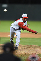 Lowell Spinners pitcher Carlos Pinales (19) delivers a pitch during a game against the Batavia Muckdogs on July 16, 2014 at Dwyer Stadium in Batavia, New York.  Lowell defeated Batavia 6-4.  (Mike Janes/Four Seam Images)