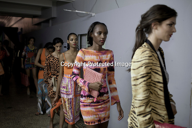 CAPE TOWN, SOUTH AFRICA - JULY 25: Models walk backstage during a fashion show with the designer label Philosophy at the Mercedes Benz Cape Town Fashion Week on July 25, 2012, in Cape Town, South Africa. Some of South Africa's finest designers showed their 2012-13 spring and summer collections during the 4-day event. (Photo by Per-Anders Pettersson)
