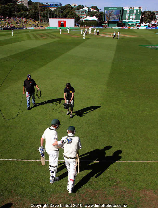 Australia's Marcus North pats Michael Clarke on the back as they walk out at the start of the second day during day two of the 1st cricket test match between the New Zealand Black Caps v Australia, day two at the Basin Reserve, Wellington, New Zealand on Saturday, 20 March 2010. Photo: Dave Lintott / lintottphoto.co.nz