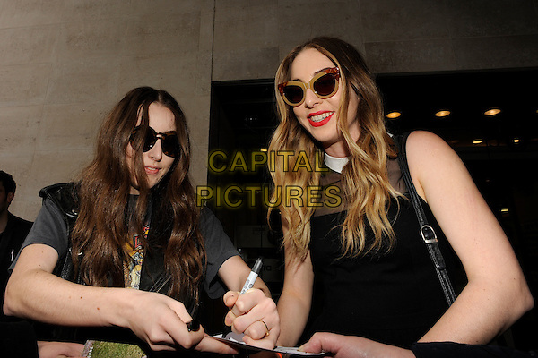 LONDON, UK - FEBRUARY 25 - Haim (Este Arielle, Danielle Sari and Alana Mychal) arriving at the Radio One Studios, London, on Tuesday,  February 25, 2014. <br /> CAP/IA<br /> &copy;Ian Allis/Capital Pictures