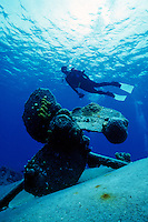 DIVER OVER SHIPWRECK'S PROPELLER<br /> Balboa<br /> Diver explores reef in search of marine life.