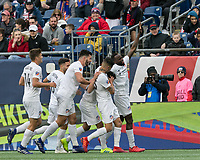 Foxborough, Massachusetts - March 24, 2019: In a Major League Soccer (MLS) match, FC Cincinnati (white) defeated New England Revolution (blue/white), 2-0, at Gillette Stadium.<br /> Kenny Saief celebrates his goal with teammates.