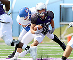 SIOUX FALLS, SD - SEPTEMBER 5: Max Mickey #22 from the University of Sioux Falls gets a step past Brock Pittsley #56 from the University of Mary in the first half of their game Saturday afternoon at Bob Young Field.  (Photo by Dave Eggen/Inertia)