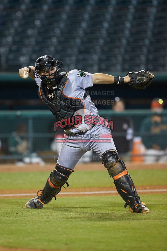 Augusta GreenJackets catcher Rob Calabrese (15) makes a throw to first base against the Greensboro Grasshoppers at First National Bank Field on April 10, 2018 in Greensboro, North Carolina.  The GreenJackets defeated the Grasshoppers 5-0.  (Brian Westerholt/Four Seam Images)