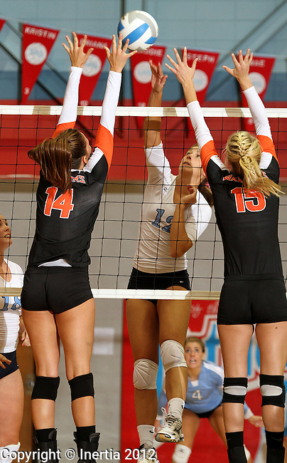 SIOUX FALLS, SD - SEPTEMBER 11: Briana Hammerstrom #12 from Lincoln tries to squeeze a kill between Lexi Bordeaux #14 and Peyton Vandebrake #15 from Washington in the second set of their match Tuesday night at Lincoln High. (Photo by Dave Eggen/Inertia)