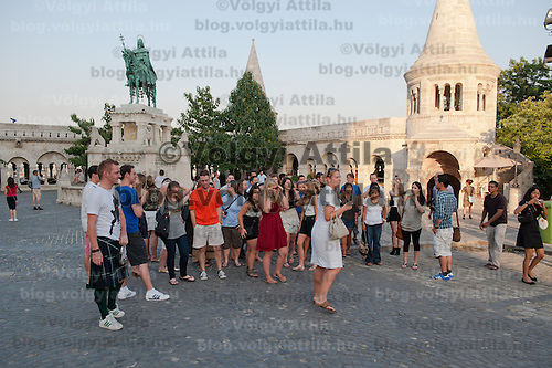A gorup of tourists walk in the castle of Buda on a summer sightseeing in Budapest, Hungary on August 25, 2011. ATTILA VOLGYI