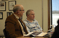 Paul Becker (left), Fayetteville chief financial officer, and Kevin Springer, budget director, address the Fayetteville City Council during an agenda session Tuesday, March 10, 2019, at Fayetteville City Hall. The administration is proposing raises for city employees that would cost about $1.3 million for the rest of the year.