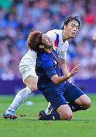 August 10, 2012..Japan's Yuki Otsu and Korean defender in action during bronze medal match at the Millennium Stadium on day fourteen in Cardiff, England. Korea defeat Japan 2-0 to win Olympic bronze medal in men's soccer.