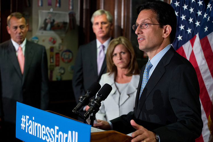 UNITED STATES - JULY 17: House Majority Leader Eric Cantor, R-Va., speaks during a news conference at the RNC after a meeting of the House Republican Conference as Speaker John Boehner, R-Ohio, left, House Majority Whip Kevin McCarthy, and Rep. Lynn Jenkins, R-Kan., look on. GOP leaders addressed issues including the health care law and immigration reform. (Photo By Tom Williams/CQ Roll Call)