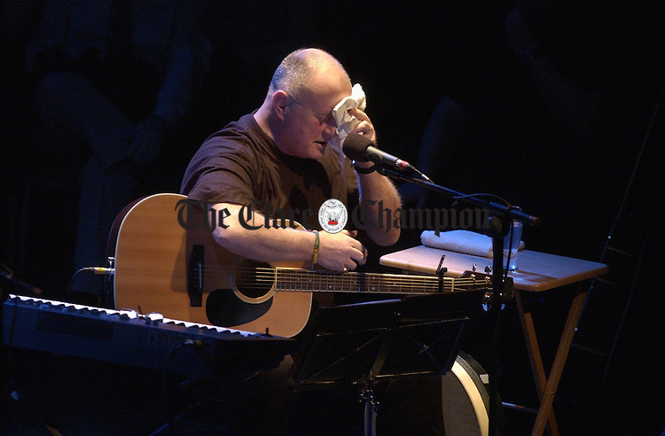 Don't forget your towel...........Christy Moore mops his perspiring brow  during the Planxty concert at the Glor Irish Musci centre, Ennis on Friday night. Photograph by John Kelly.