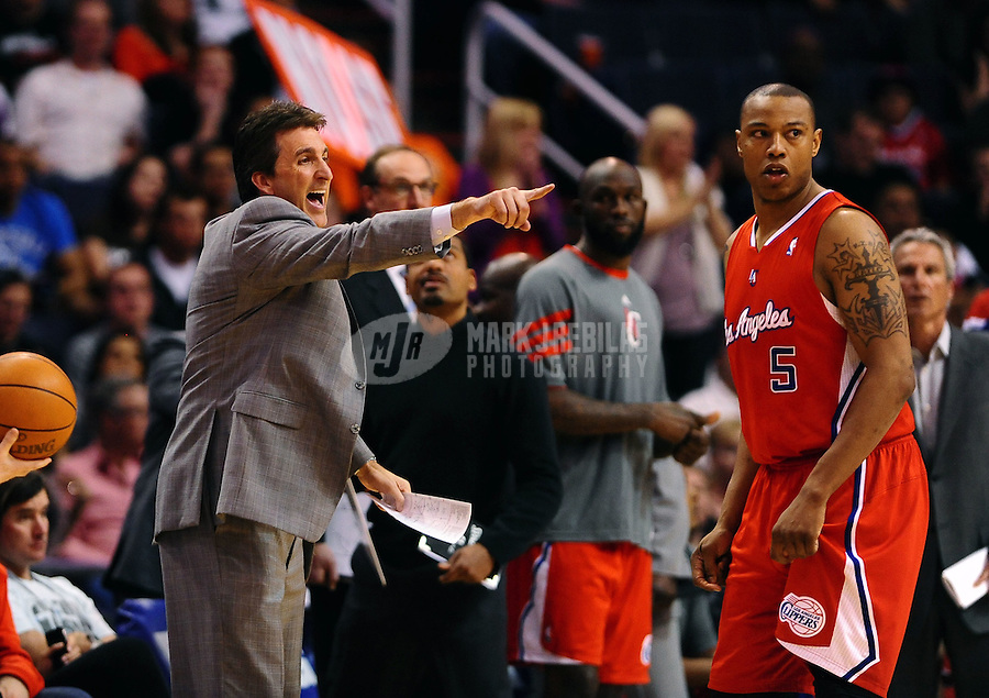 Mar. 2, 2012; Phoenix, AZ, USA; Los Angeles Clippers forward Caron Butler (left) and head coach Vinny del Negro against the Phoenix Suns at the US Airways Center. The Suns defeated the Clippers 81-78. Mandatory Credit: Mark J. Rebilas-USA TODAY Sports