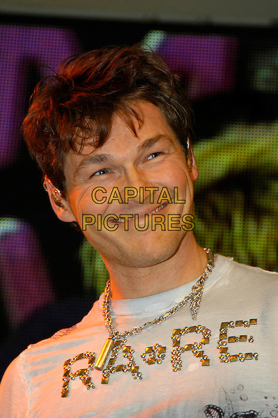 MORTEN HARKET OF A-HA.A-Ha Instore Gig and Signing,.HMV Oxford Street, .London, England, .30th January 2006..portrait headshot on stage performing concert music band t-shirt Rare slogan funny smiling.Ref:HT.www.capitalpictures.com.sales@capitalpictures.com.©Capital Pictures