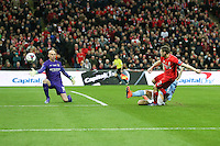 James Milner of Liverpool (right) misses a good opportunity to equalise during the Capital One Cup match between Liverpool and Manchester City at Wembley Stadium, London, England on 28 February 2016. Photo by David Horn / PRiME Media Images.