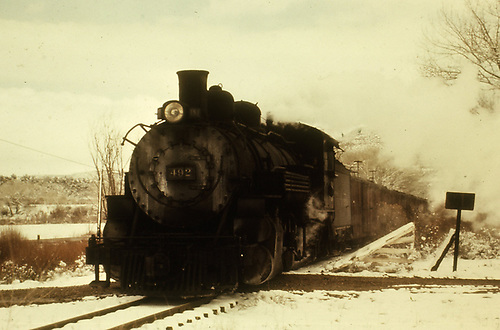 D&amp;RGW #492 with a freight crossing a country road in winter.<br /> D&amp;RGW