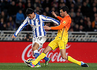Real Sociedad's Chory Castro (l) and FC Barcelona's Sergio Busquets during La Liga match.January 19,2013. (ALTERPHOTOS/Acero) /NortePhoto