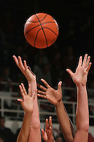 STANFORD, CA - FEBRUARY 4:  A basketball and hands during Stanford's 74-53 win over UCLA on February 4, 2010 at Maples Pavilion in Stanford, California.