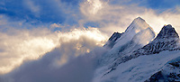 Wetterhorn Mountain in clouds at sunset. Swiss Alps, Switzerland